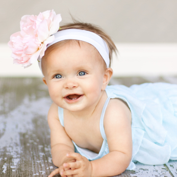 Baby Girl with Flower on Head