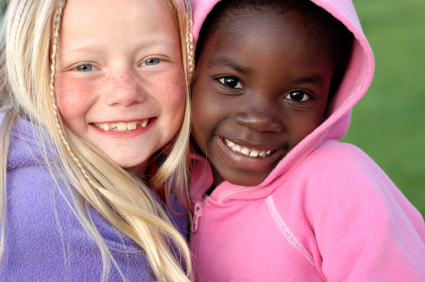 Young Caucasian and African American girls smiling