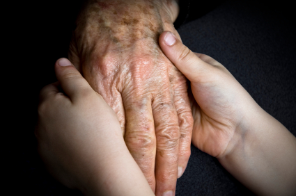 Elderly hands with young hands