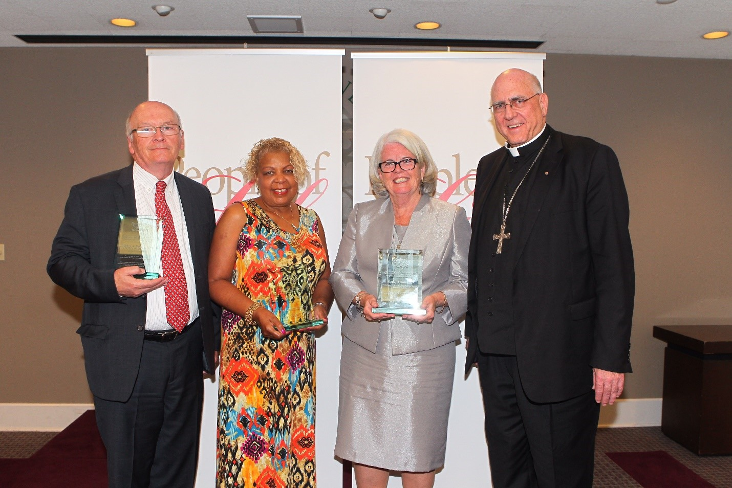 (Left to Right) People of Life awardees Chuck Donovan, Cheryl Holley and Marian Desrosiers with Archbishop Naumann, Chairman of the US Bishops' Committee on Pro-Life Activities Photo Credit: Tim Porco