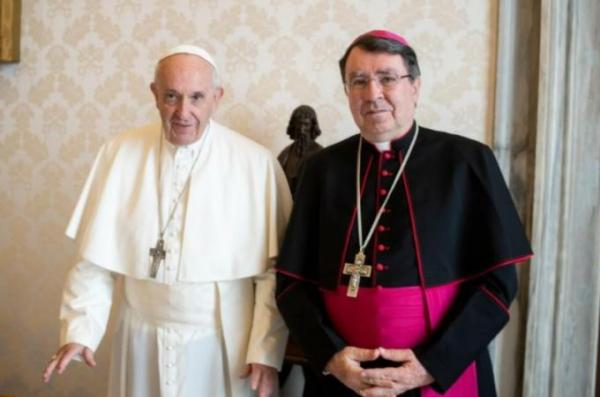 Pope Francis poses for a photo with Archbishop Christophe Pierre, apostolic nuncio to the United States, at the Vatican Nov. 10. Archbishop Pierre returned to the United States the following day in time for the Nov. 12 opening of the U.S. bishops' general assembly in Baltimore. (CNS photo/Vatican Media)