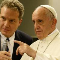 Greg Burke, Vatican spokesman, is seen with Pope Francis aboard the flight from Dhaka, Bangladesh, to Rome Dec. 2, 2017. (CNS photo/Paul Haring