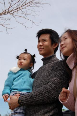 Asian couple with child